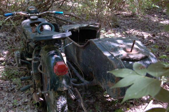 Мотор с кош, изваден от тинята